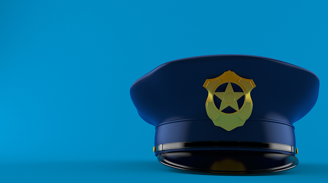 police hat on blue background